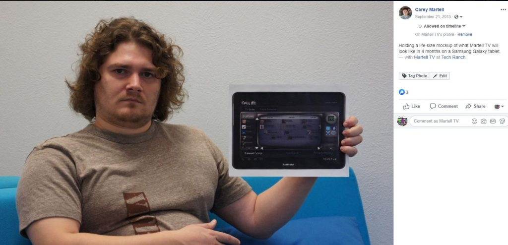 A photo of myself from 2013, posing with a mockup of what I envisioned my video streaming platform interface to look like.